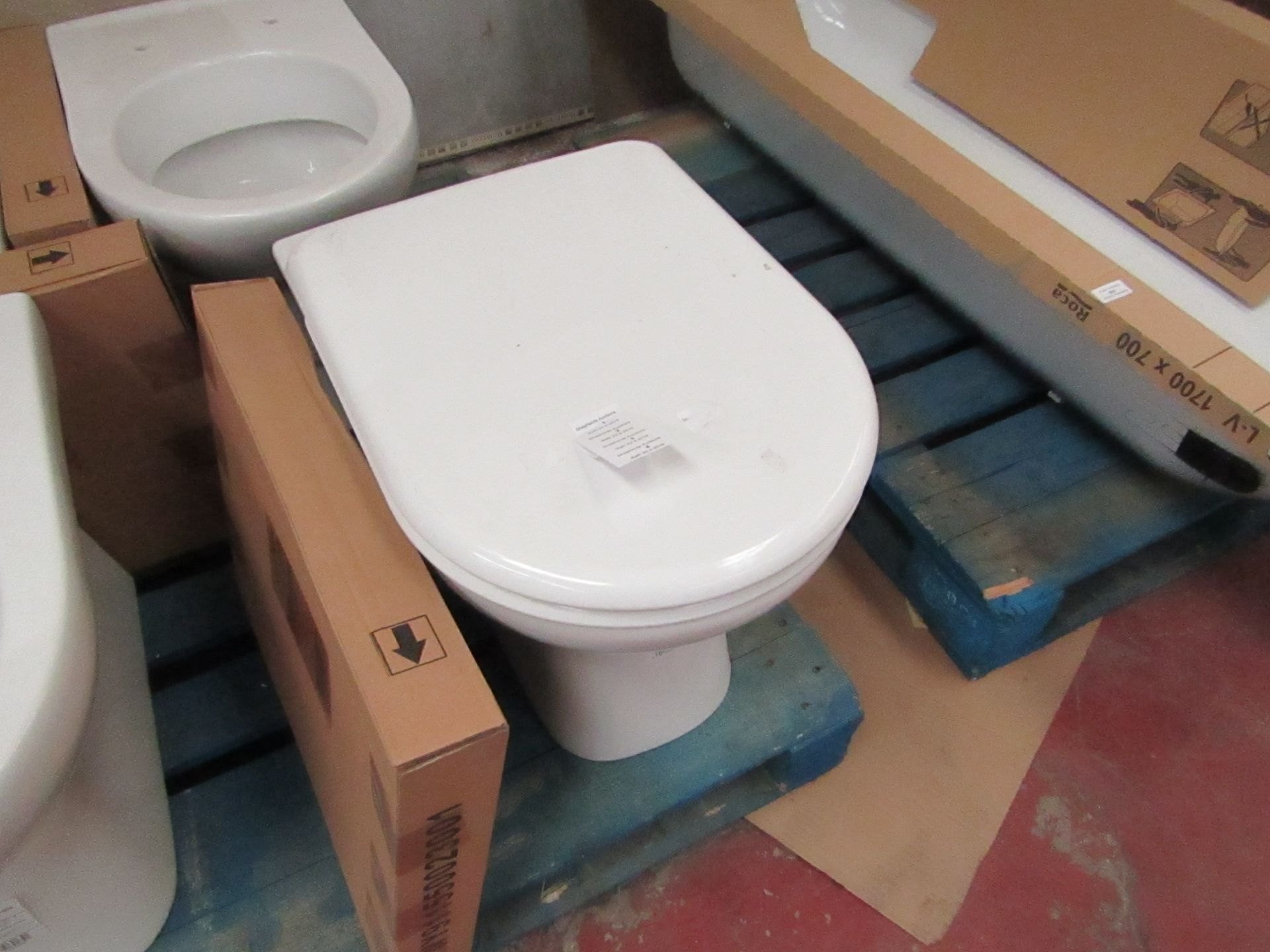 Lotto 3 - Jika Deep floor mounted back to wall toilet pan with toilet seat, new