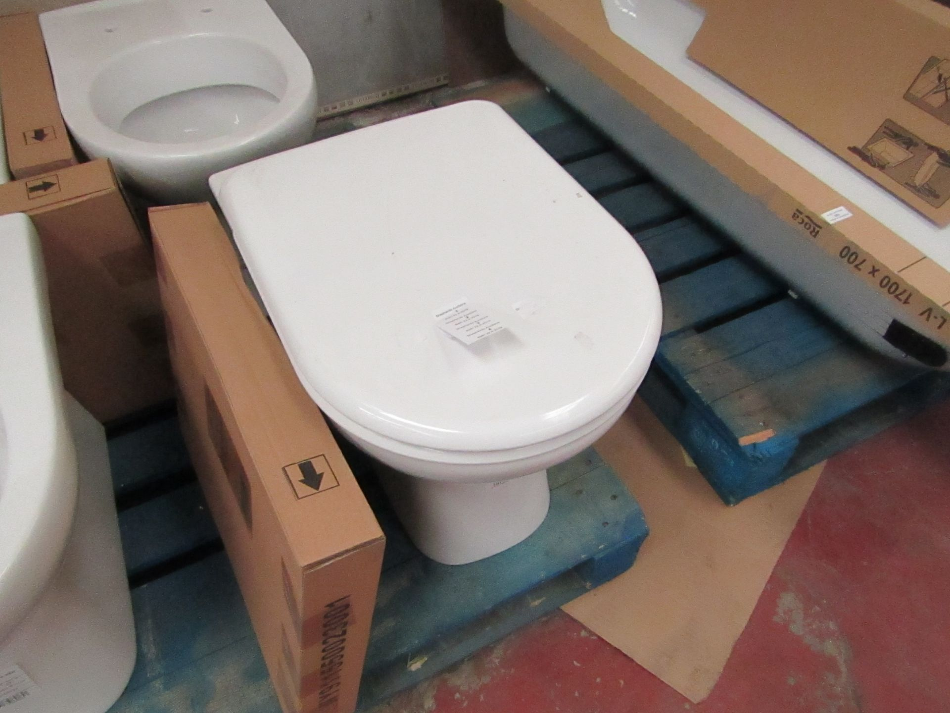 Lotto 2 - Jika Deep floor mounted back to wall toilet pan with toilet seat, new