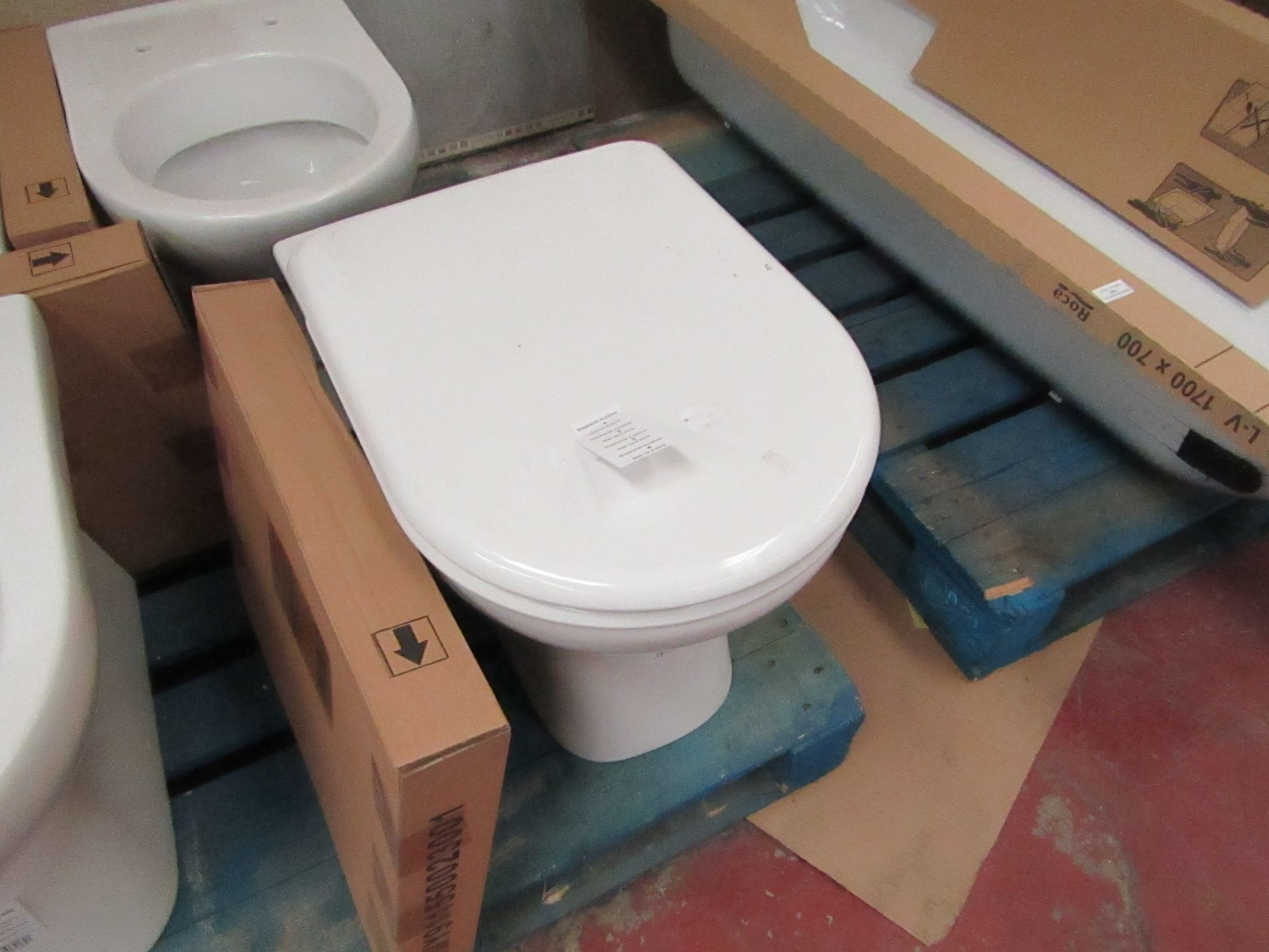 Lotto 4 - Jika Deep floor mounted back to wall toilet pan with toilet seat, new