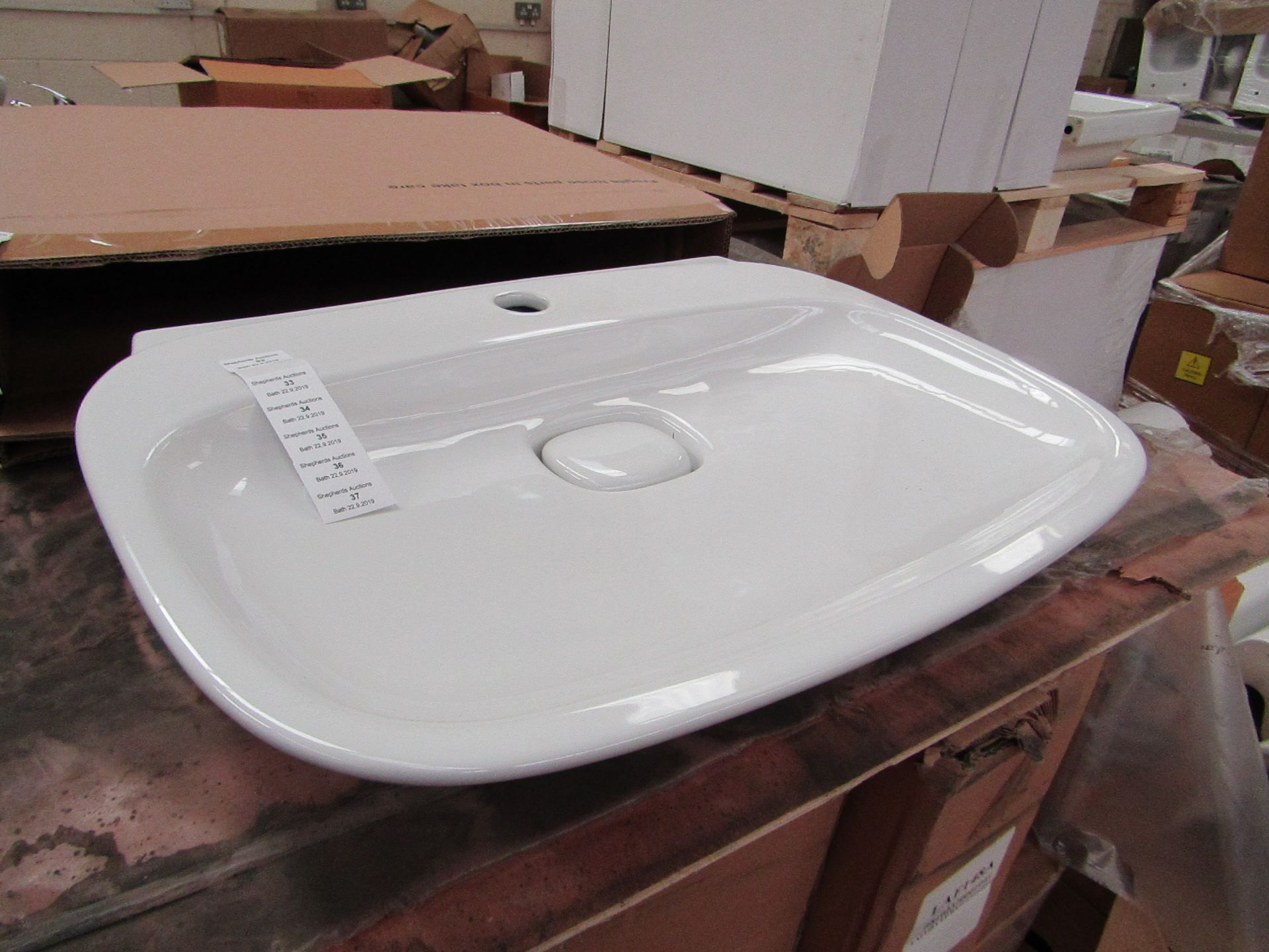 Lotto 36 - Laufen Made 60cm Sink with Ceramic plug hole cover, new and boxed