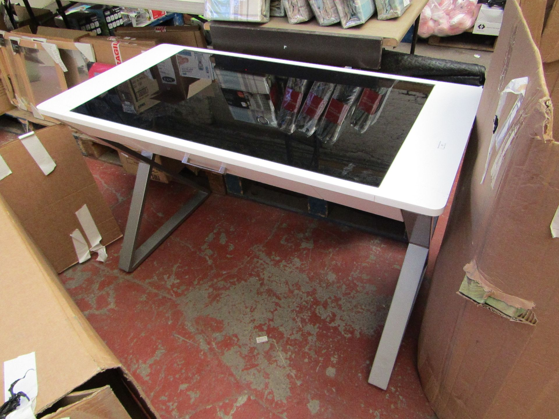 Lot 27 - Bayside furnishings writing desk with tempered glass top and storage drawer, no major damage.