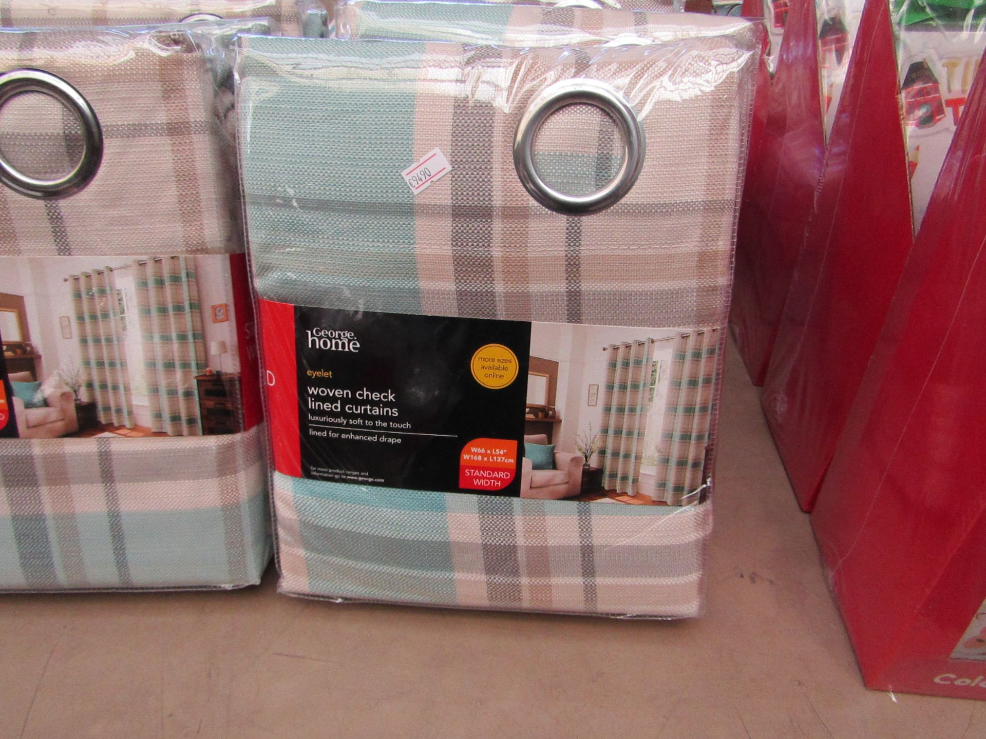 "Lot 12 - George Home woven checkered lined curtains, W 66 x L 54"", new and packaged."