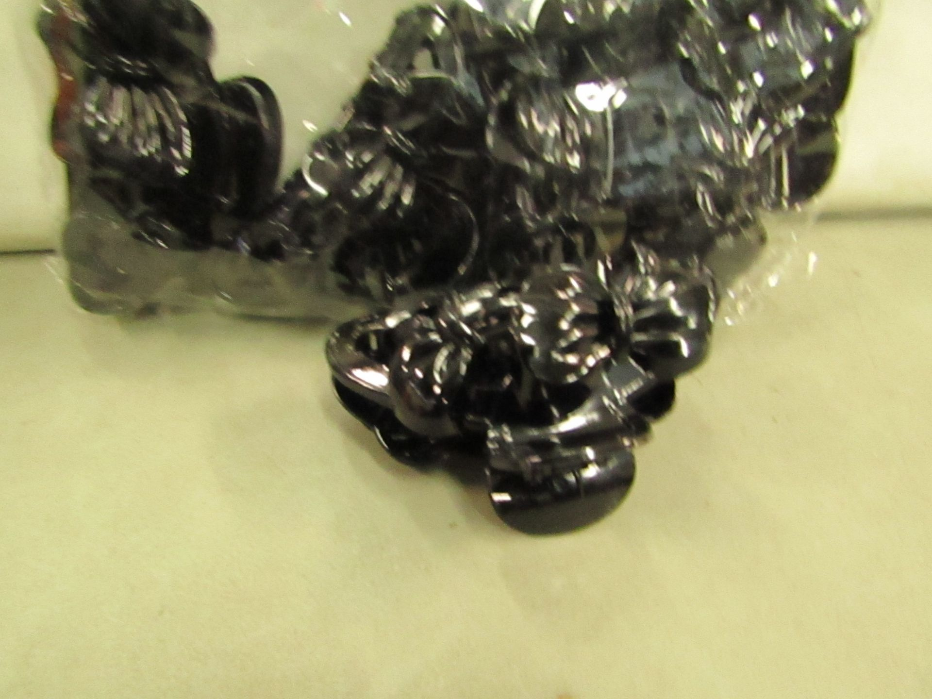 Lot 295 - 12 x Black X Large Hair Claws RRP £1.50 each @ Claire's Accessories new & packaged