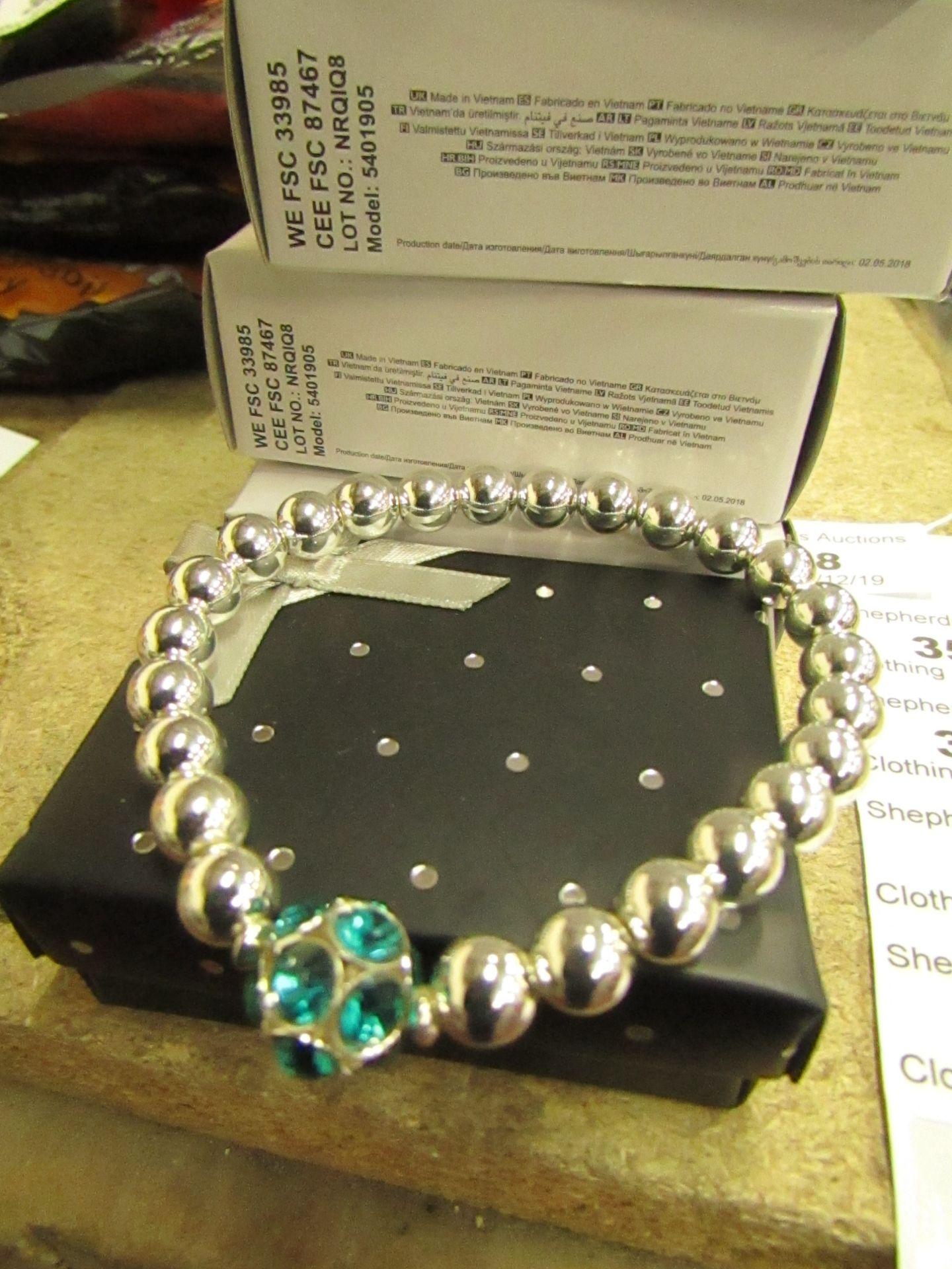 Lot 362 - 3 x Avon Brooke Stretch Sliver coloured Bead & Blue Zircon Bracelets in Gift Box new