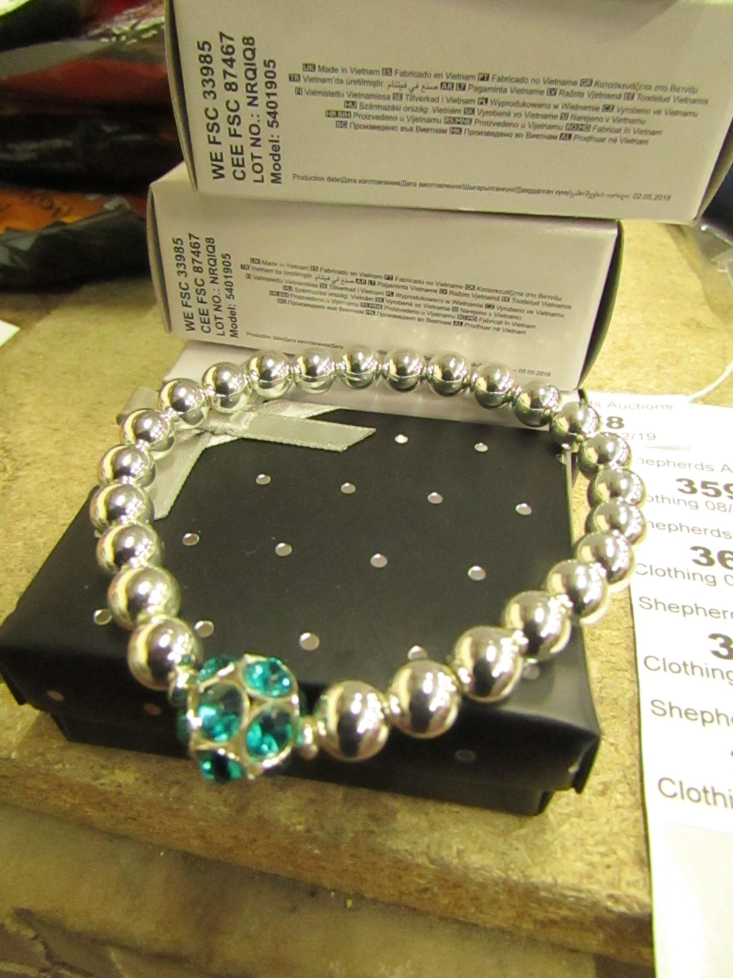 Lot 360 - 3 x Avon Brooke Stretch Sliver coloured Bead & Blue Zircon Bracelets in Gift Box new