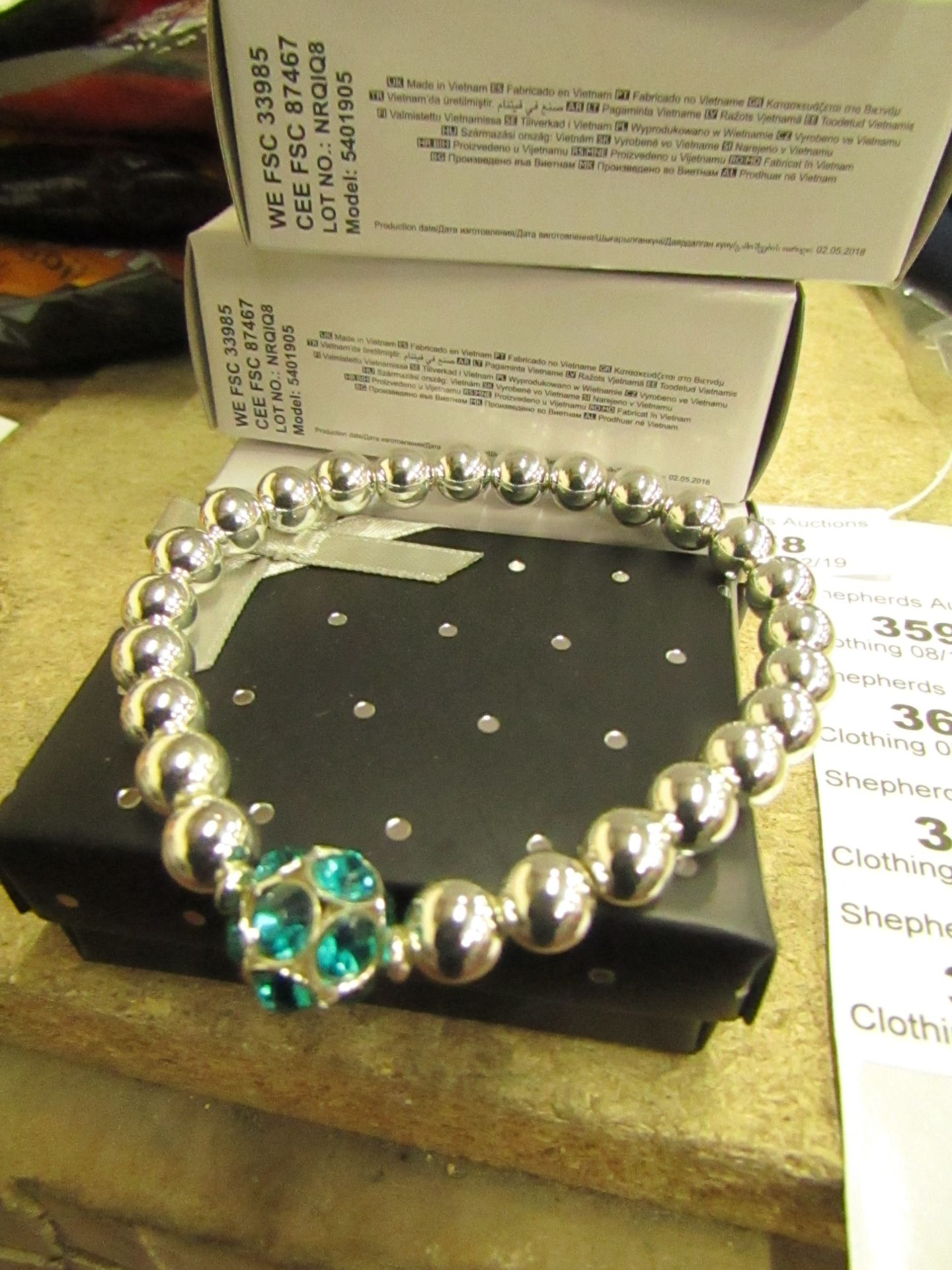 Lot 359 - 3 x Avon Brooke Stretch Sliver coloured Bead & Blue Zircon Bracelets in Gift Box new
