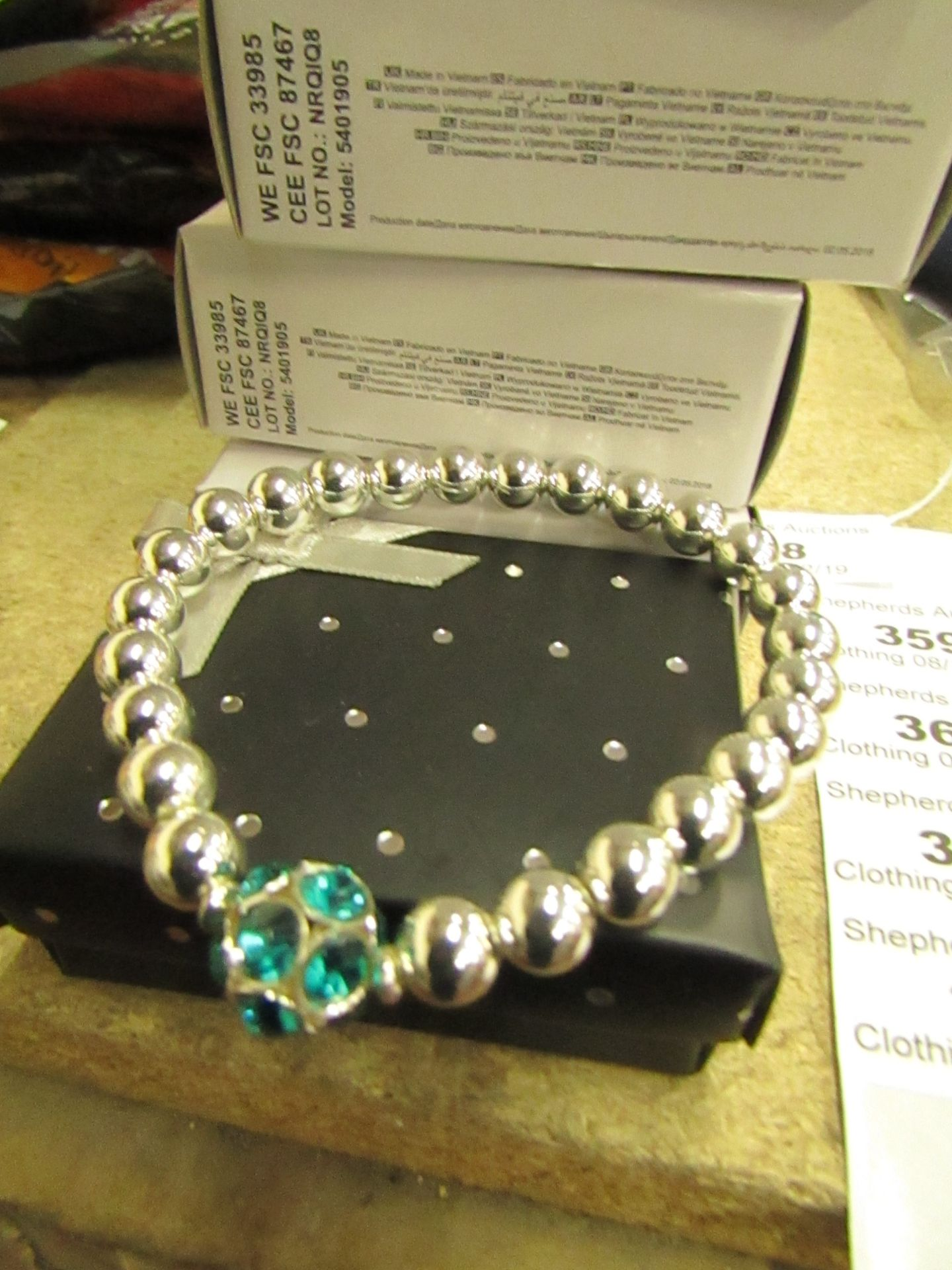 Lot 358 - 3 x Avon Brooke Stretch Sliver coloured Bead & Blue Zircon Bracelets in Gift Box new
