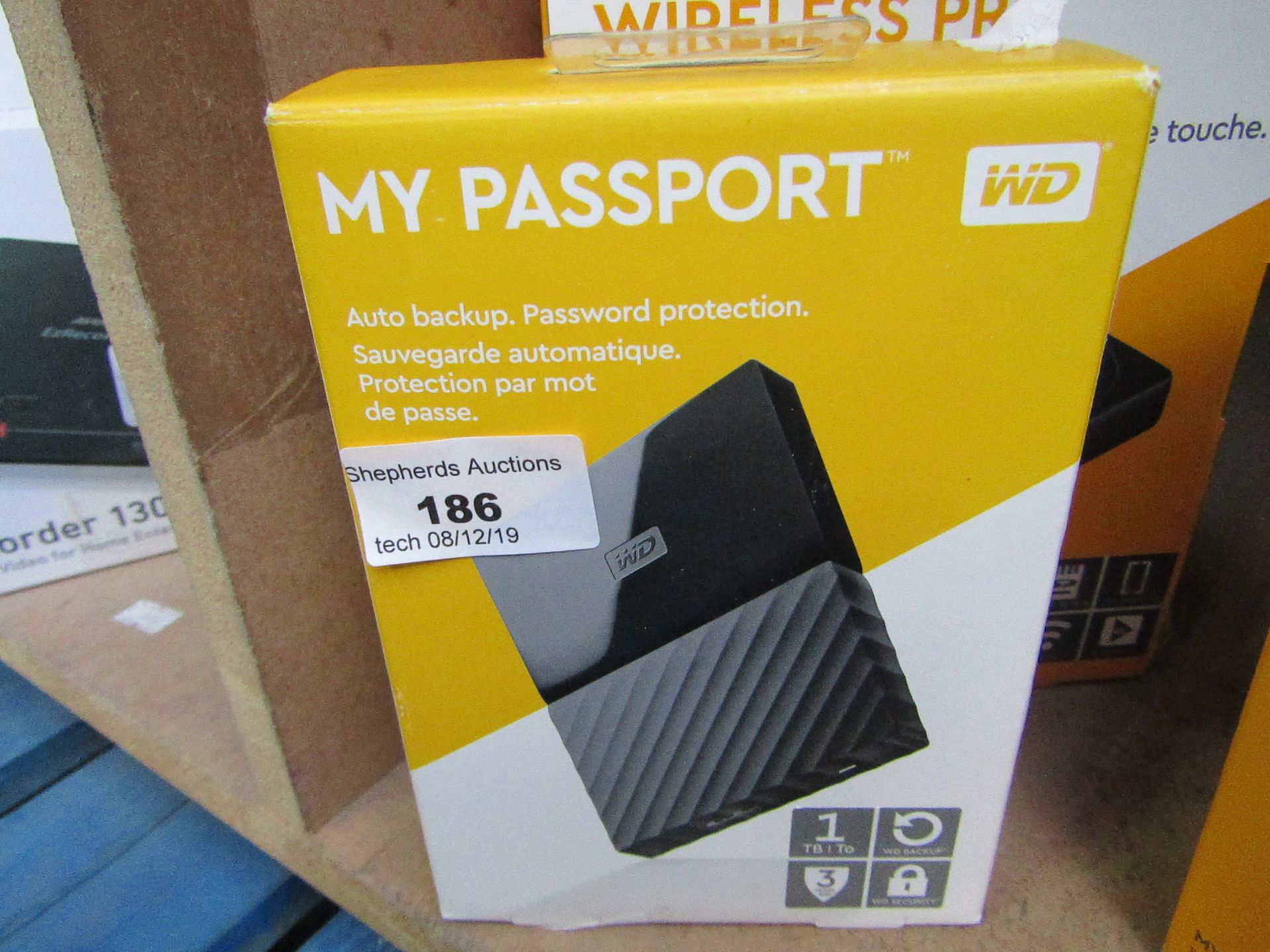 Lot 186 - Western Digital My Passport auto back up 1TB, untested and boxed.