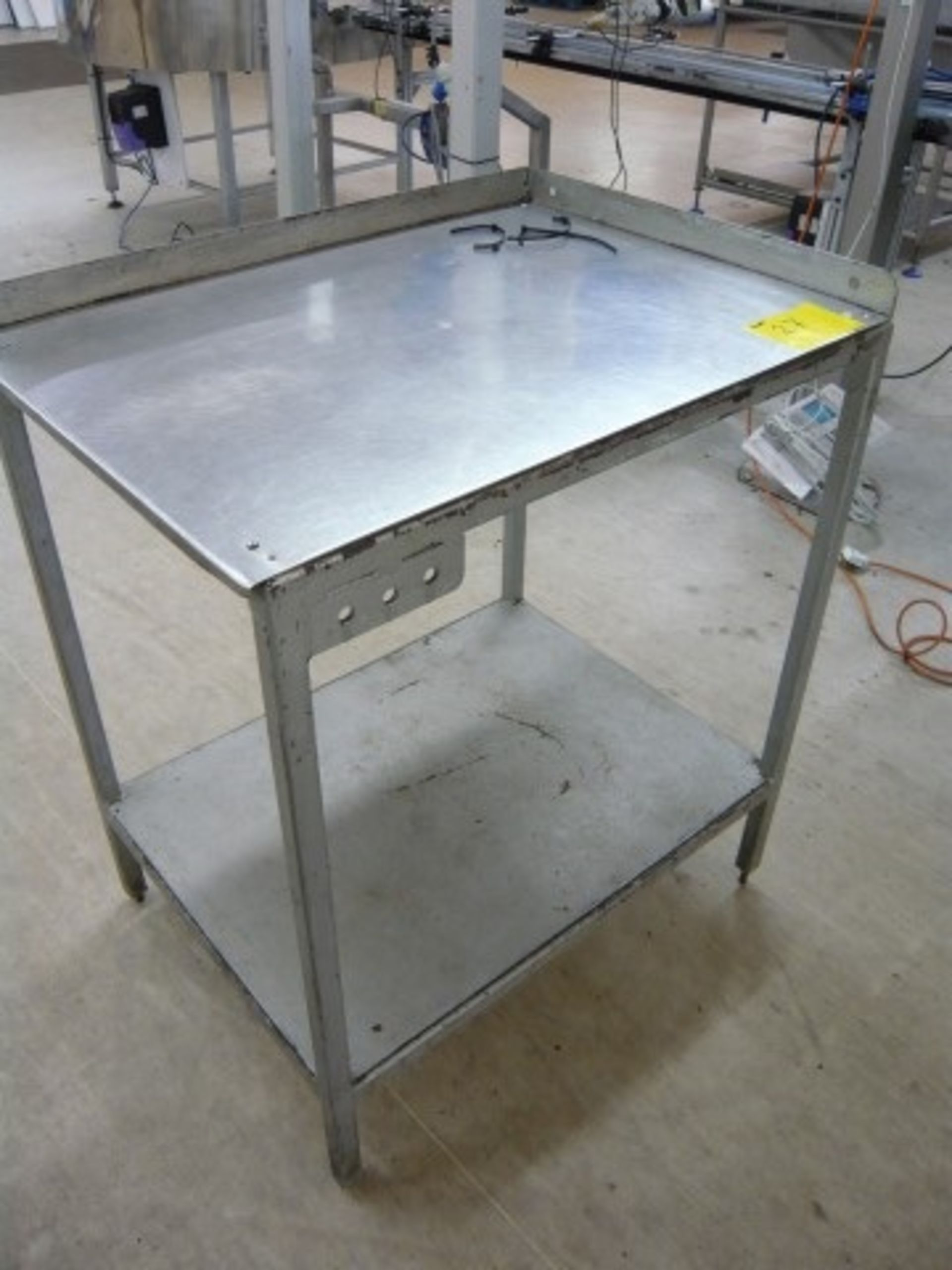 Lot 027 - (6) Stainless steel topped packing station tables