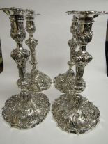 Lot 353 - A set of 4 solid silver Georgian candlesticks by William Brown, London 1827, highly repousse