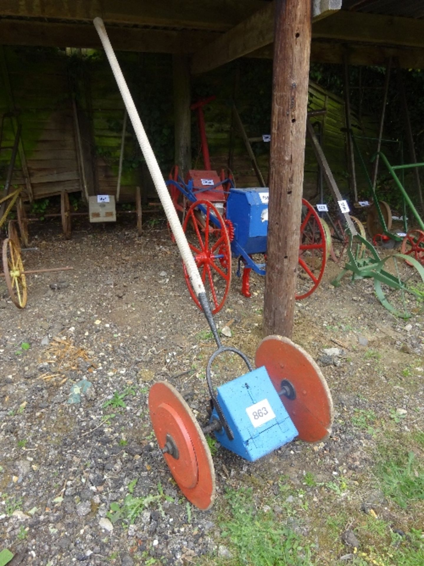 Lot 863 - Single row long pole hand drill on wooden wheels