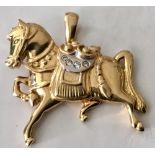 Lot 310 - 18ct gold horse pendant set with diamond & an articulated bail, 7gms. Estimate £250-300