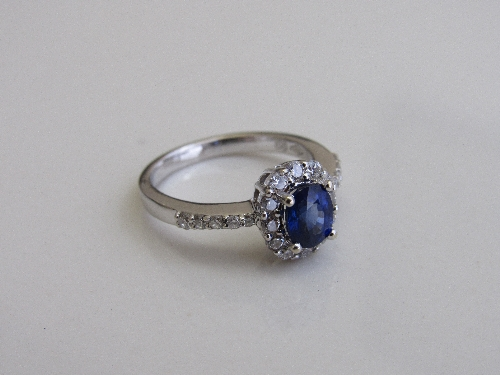 Lot 337 - 18ct white gold, sapphire & diamond ring, size M 1/2, weight 4.3gms. Estimate £200-250.