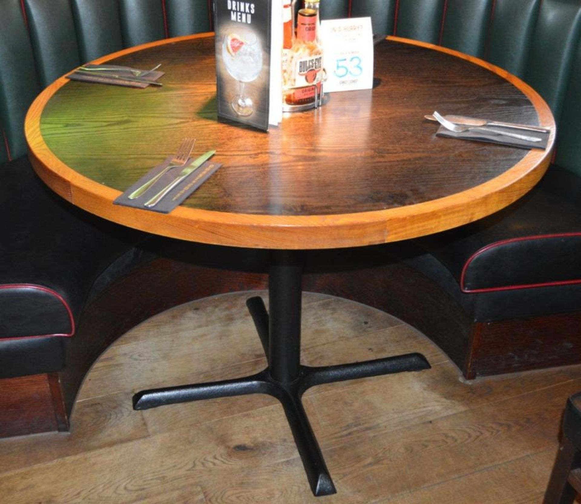 Lot 154 - 1 x Restaurant Dining Table With Cast Iron Base - Two Tone Wooden Finish With Shaped Edges - H76 x