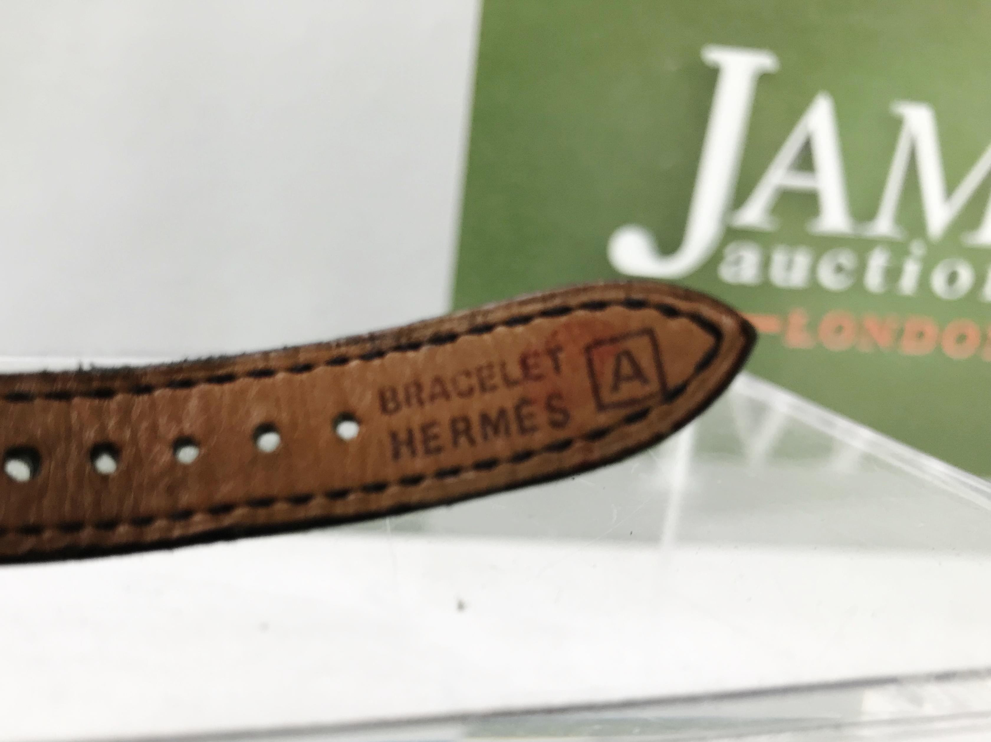 Lot 17 - Hermes Kelly Classic-Black & Gold Bracelet/Watch