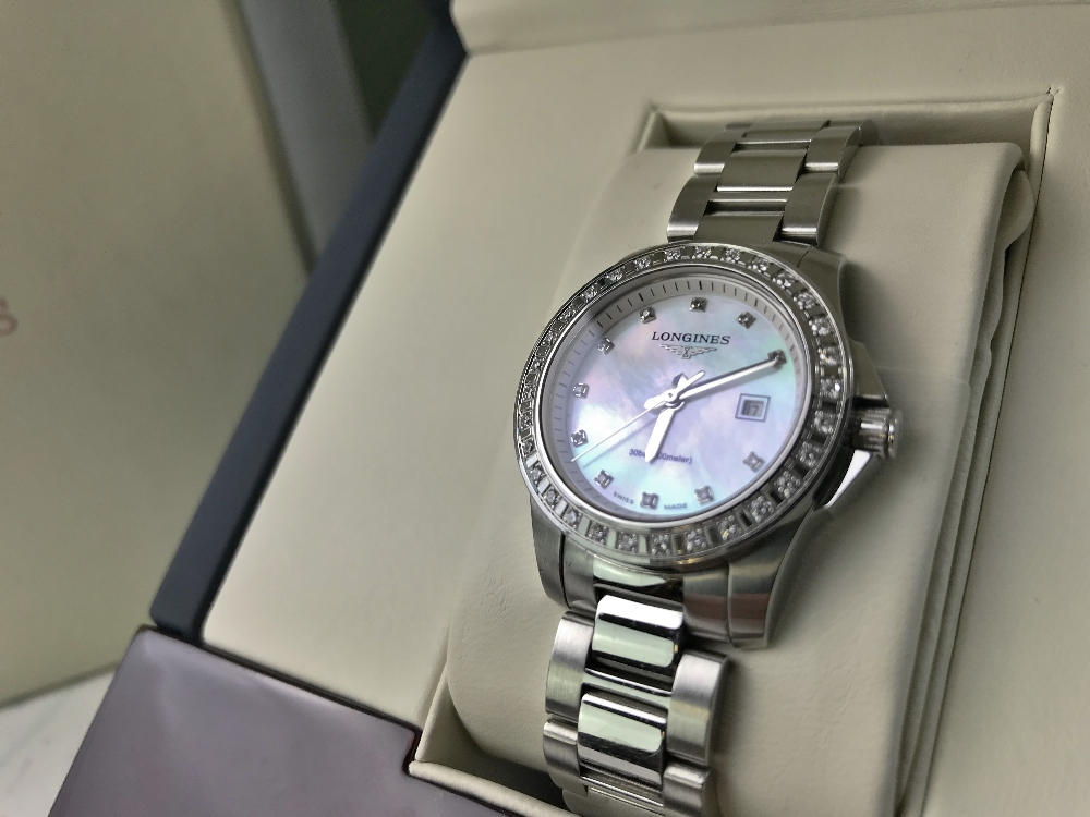 Lot 22 - Longines Ladies Diamond Factory Set Bezel Watch