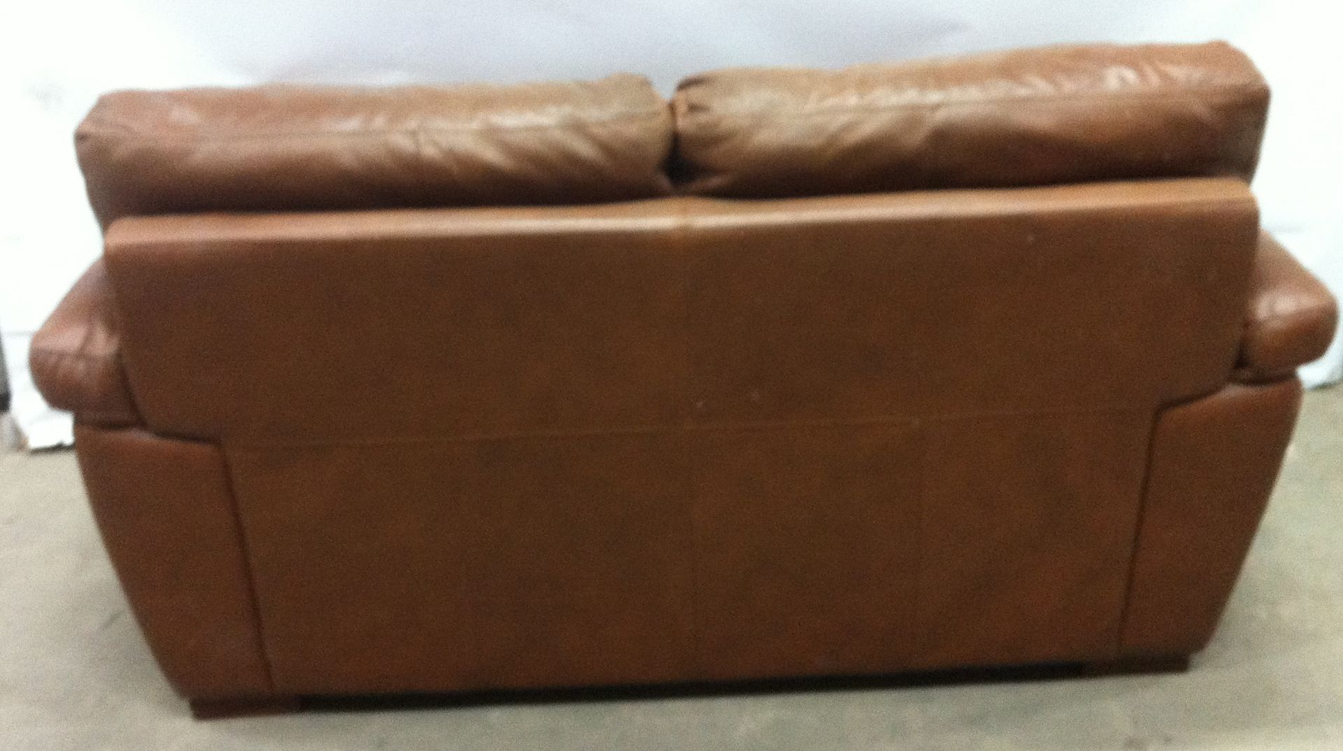 Lot 16A - 2 Seat Tan Faux Leather Couch