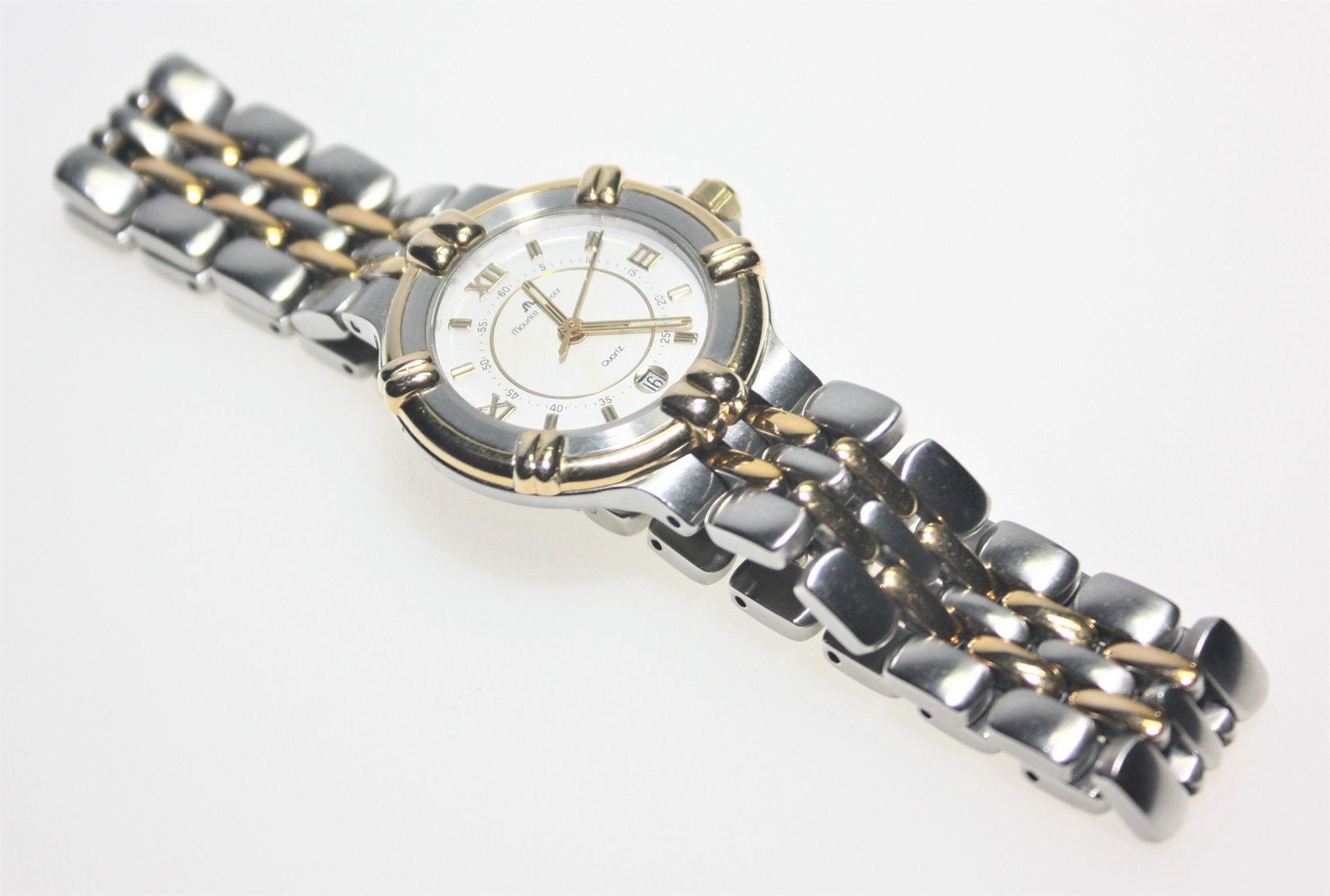 "Moderne Damen-Armbanduhr Stahl/vergoldet ""Maurice la Croix"", Quarz, Datum bei ""6"". Brgw. 56,9 g"