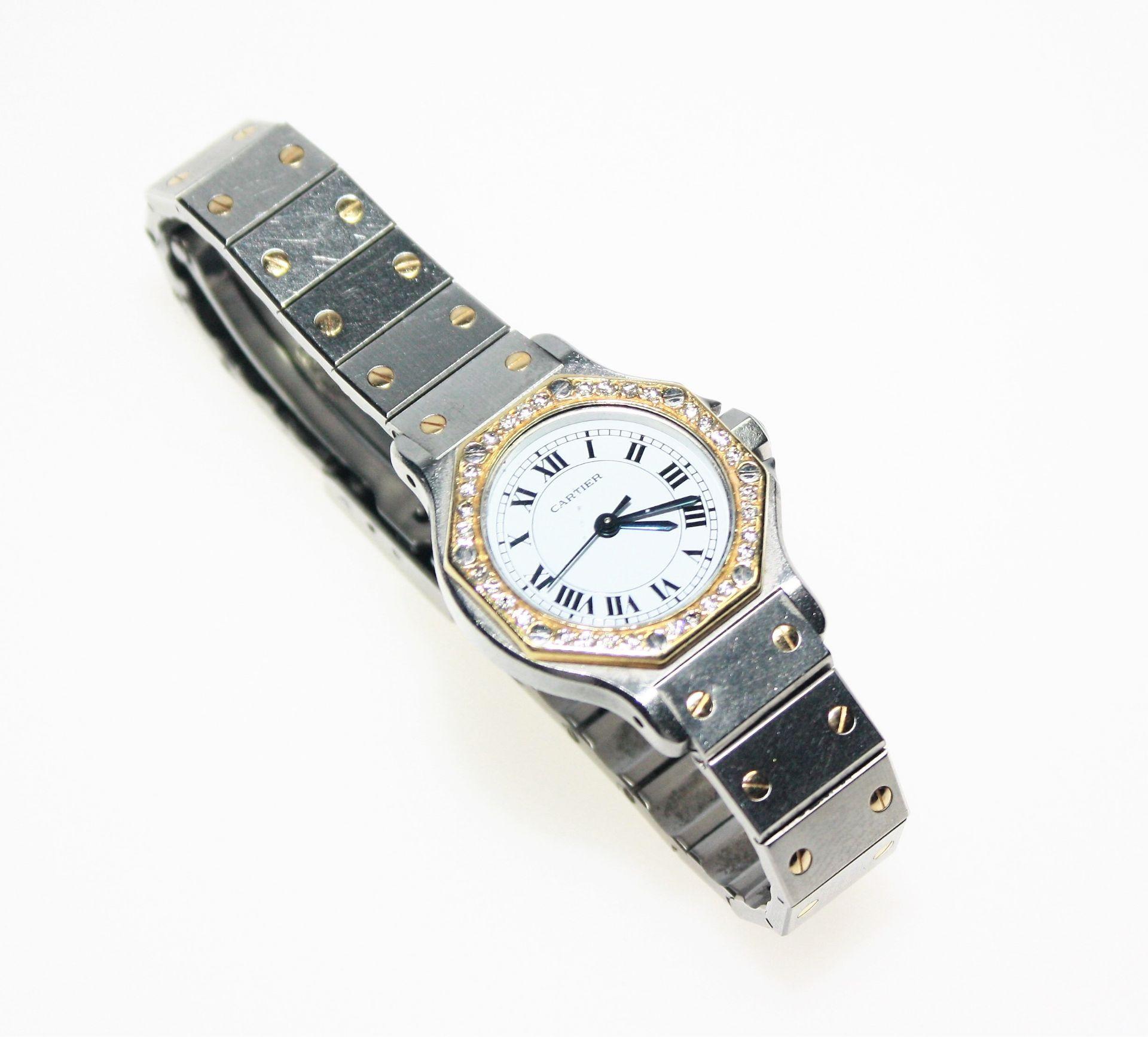 """Damen-Armbanduhr Stahl/Gold """"Cartier"""", rundes, weißes Zifferblatt mit römischen Ziffern, umgeben von"""