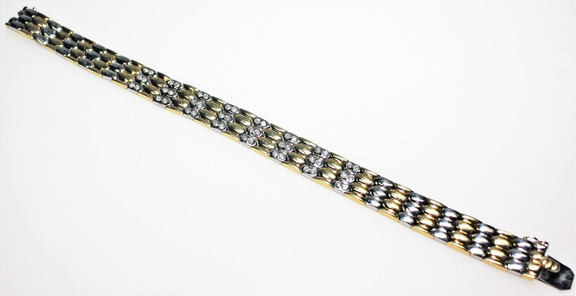 Modernes Armband in Gelb- und Weißgold 750/f gest., zur Mitte weiß goldene Teile ausgefasst mit
