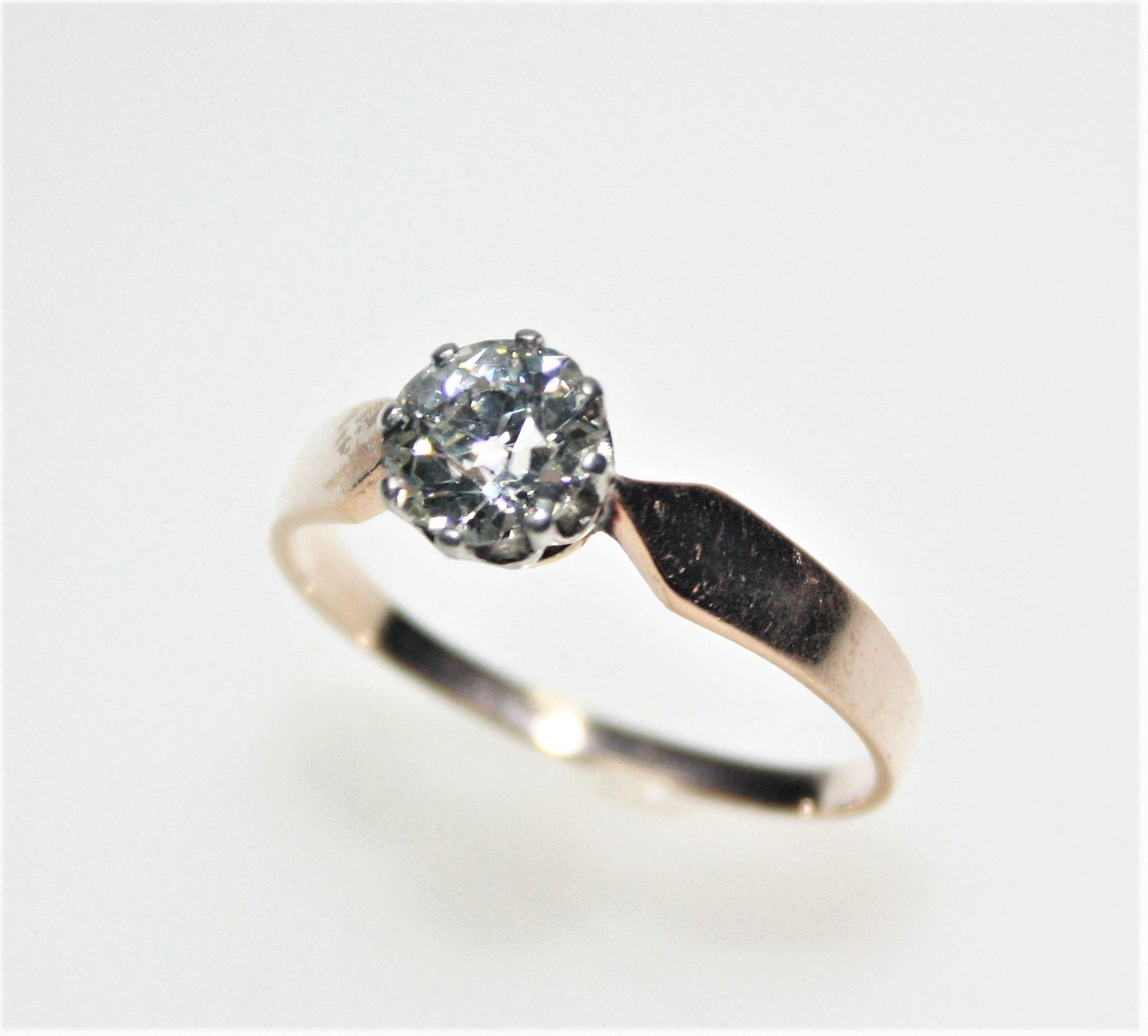 Älterer, goldener Ring ca. 585/f, in weißgoldener Krönchenfassung ein Diamant in Brillant-Altschliff