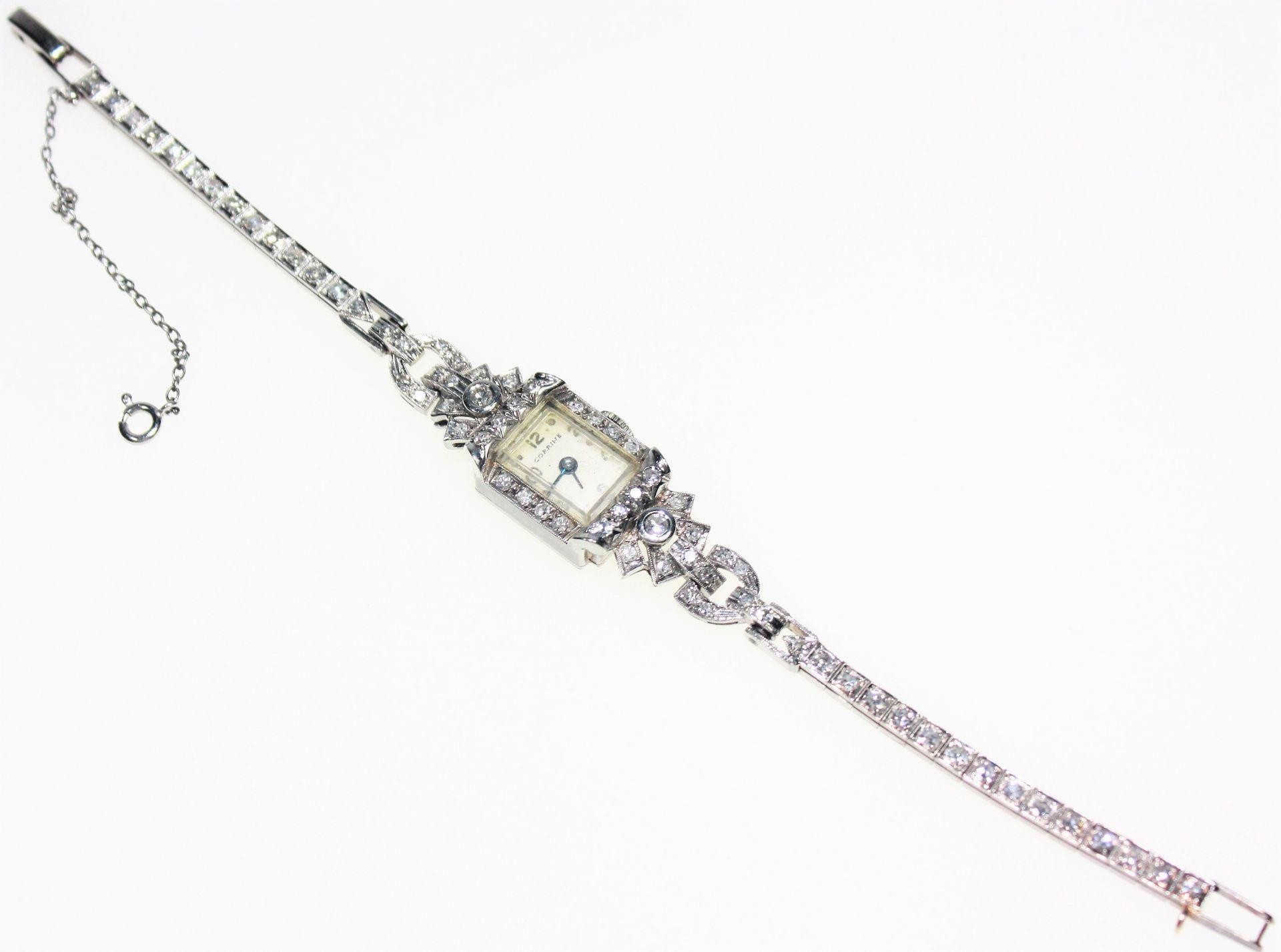 Ältere, schmale Damen-Armbanduhr 14 K gest. Art Deco, voll ausgefasst mit Diamanten in