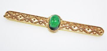 Ältere, goldene Stabnadel, Handarbeit, mit einem ovalen, grünen Turmalincabochon ca. 22,4 x 18,5