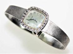 """Weißgoldene Damen-Armbanduhr 585/f gest., stumpf/quadratisches Zifferblatt bezeichnet """"Rome"""","""