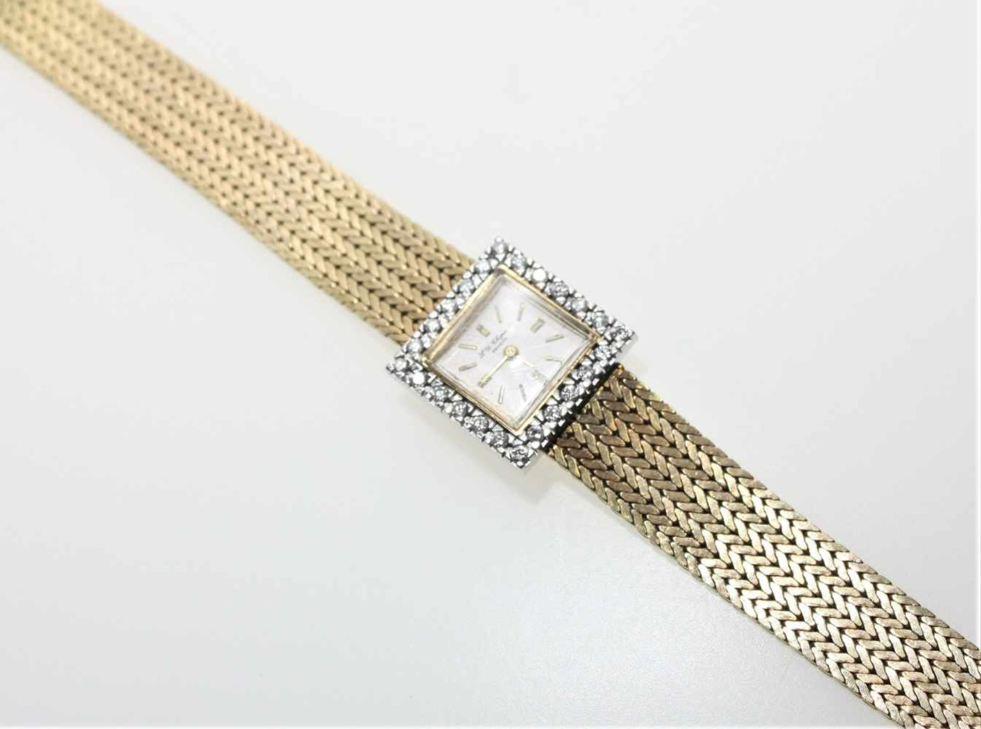 """Goldene Damen-Armbanduhr 750/f gest., quadratisches Zifferblatt bezeichnet """"L.-U. Chopard"""","""