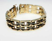Goldenes Gliederarmband 585/f gest., offen gearbeitet, ca. 2 cm breit, 19,5 cm lang.Brgw. 39,6 g