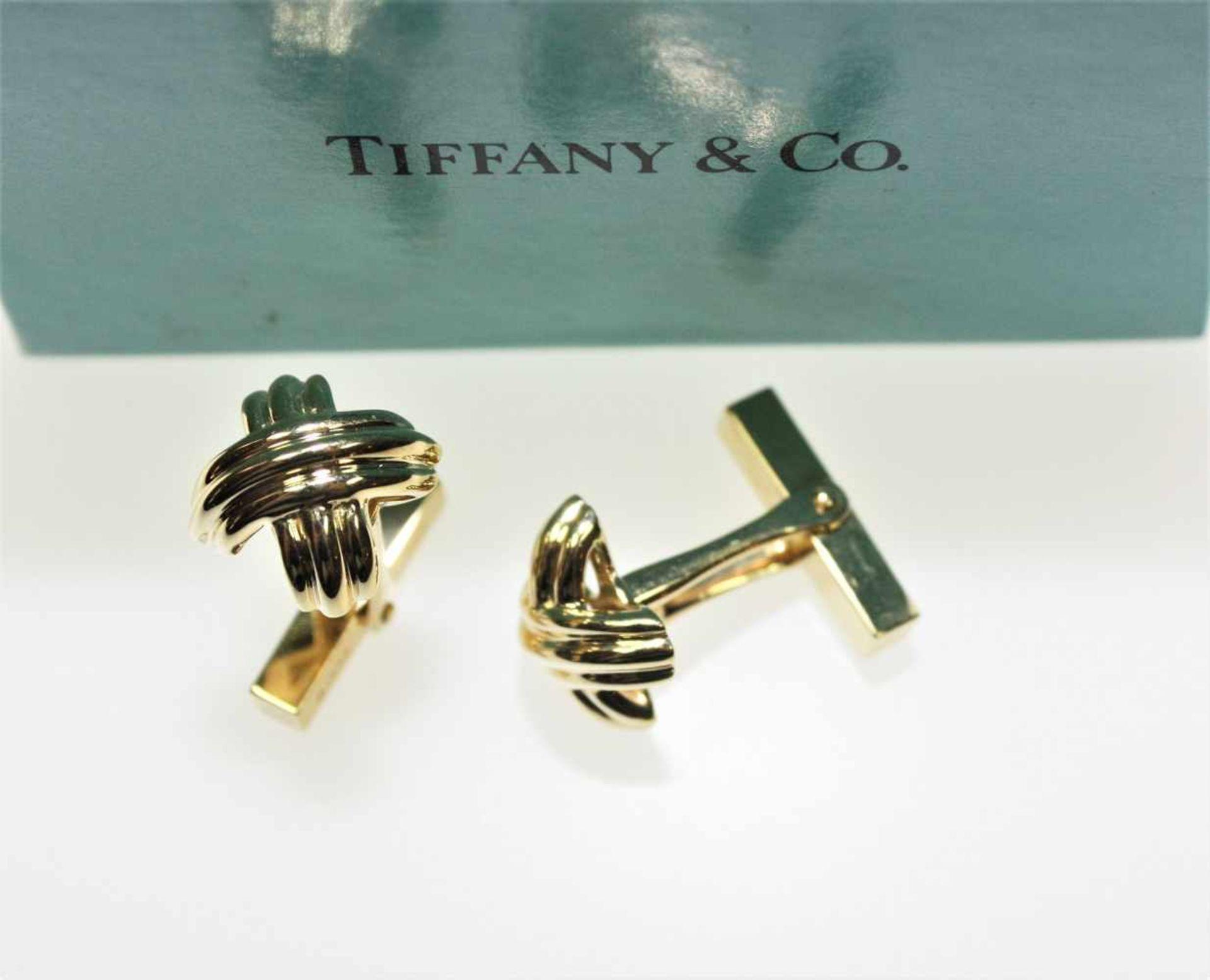 """Feine, goldene Manschettenknöpfe 750/f gest. signiert """"Tiffany & Co"""", mit Original-Schatulle,"""