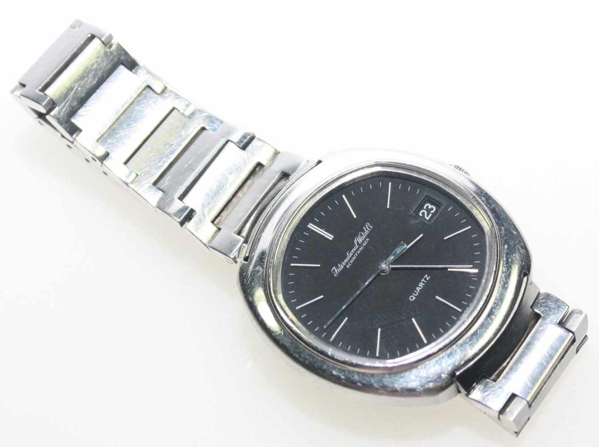 """Los 14 - Herren-Armbanduhr Stahl, dunkles Zifferblatt bezeichnet """"International Watch Co."""", Schaffhausen,"""