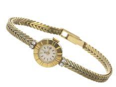 Armbanduhr: vintage Damenuhr der Marke Ebel, ca. 1960Ca. Ø16mm, ca. 18cm lang, ca. 23g, 14K Gold,