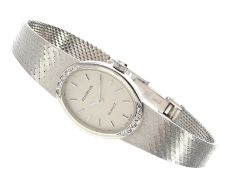 Armbanduhr: elegante, weißgoldene Dugena Damenuhr mit DiamantbesatzCa. 16 × 21mm, ca. 16cm lang, ca.