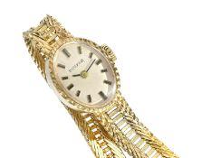 """Armbanduhr: goldene vintage Damenuhr der Marke """"Dugena""""Ca. 17,5cm lang, ca. 20,1g, 14K Gold,"""