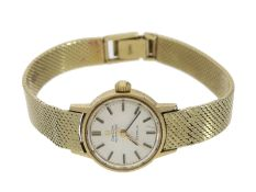 Armbanduhr: goldene vintage Automatik-Damenarmbanduhr der Marke Omega, 18K Gold, Referenz 565.002Ca.