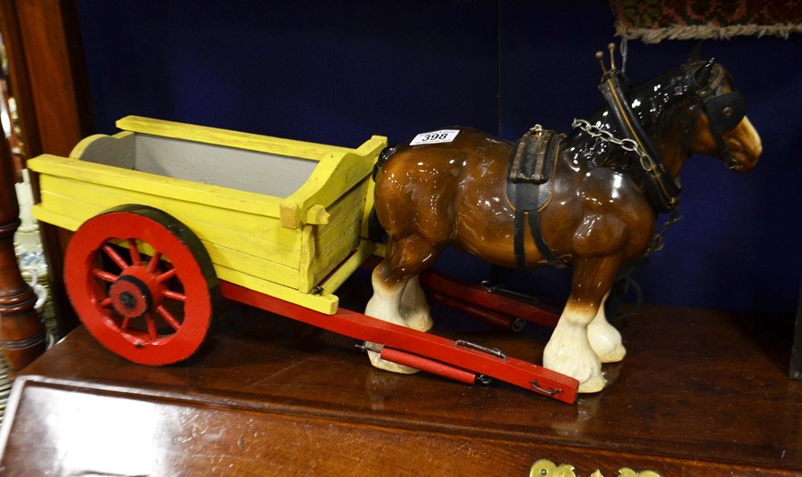 Lot 398 - A Staffordshire Shire horse and painted wooden cart