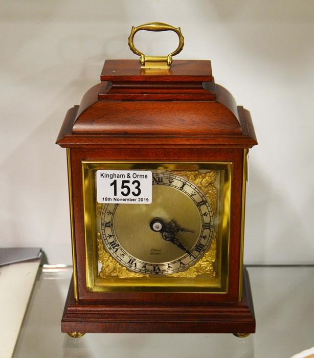 Lot 153 - A brass and wooden mantle clock, Elliott, London,