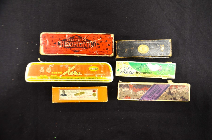 Lot 356 - Assorted cased harmonicas, three penknives and miscellaneous objects (11)