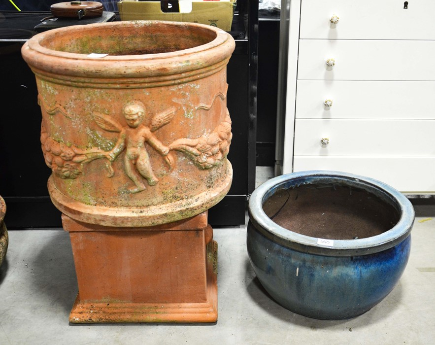 Lot 540 - A terracotta circular planter with cherub moulded frieze 50cm diameter , a terracotta pedestal and