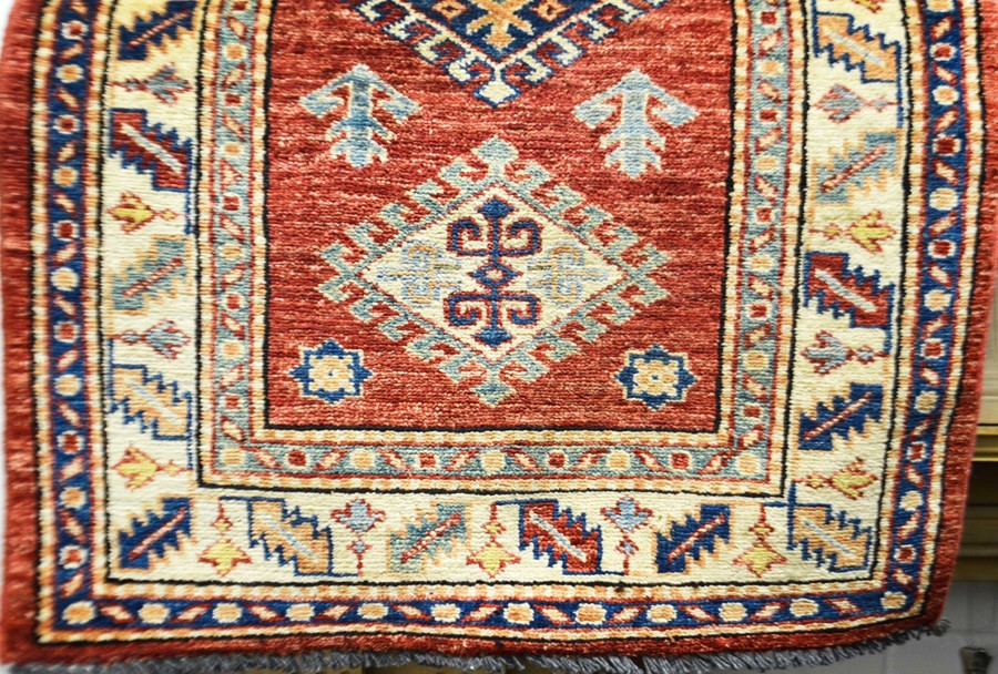 Lot 289 - A small Kazak design mat