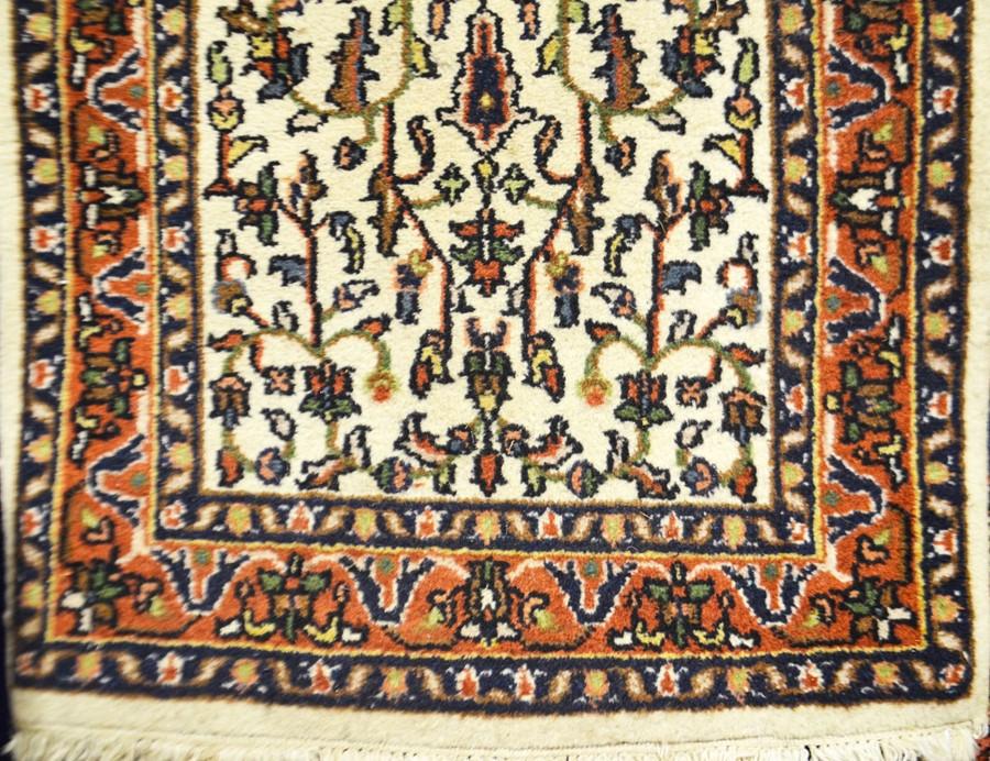 Lot 298 - A Persian wool carpet, ivory ground, 73cm x 137cm