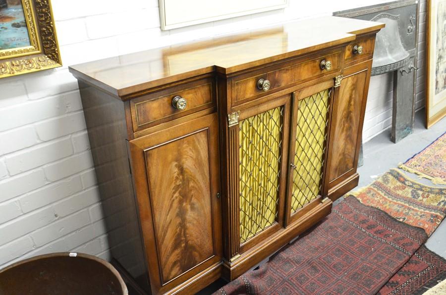 Lot 462 - Mahogany breakfront Regency style two door cabinet, height 89cm