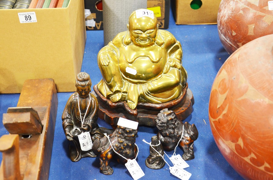 Lot 91 - A large brass seated figure of Budda on a wooden s
