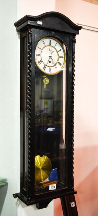 Lot 459 - Ebonised Vienna wall clock.