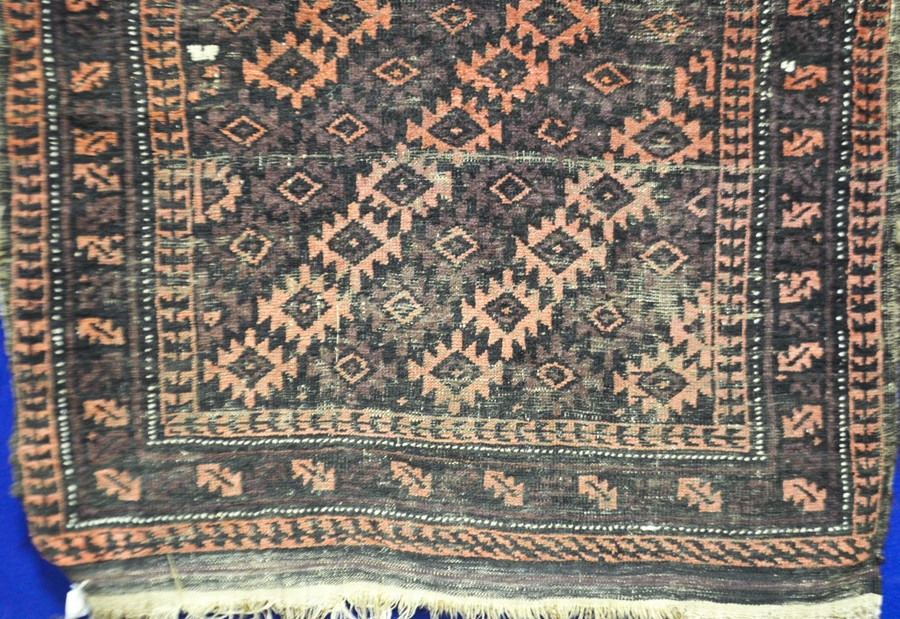 Lot 293 - A Caucasian style rug