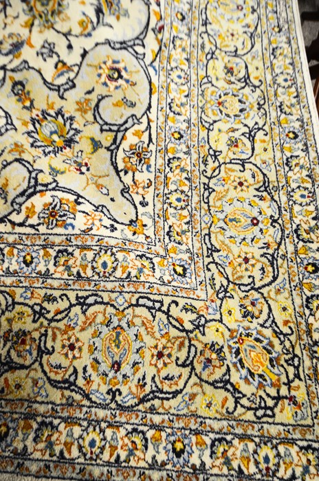 Lot 318a - A large floral patterned rug with central medallion