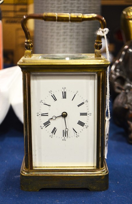 Lot 84 - A late 19th century gilt brass carriage clock.