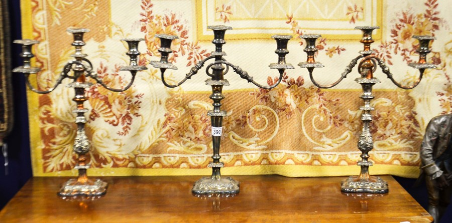 Lot 390 - A garniture of silver plated three branch candelab