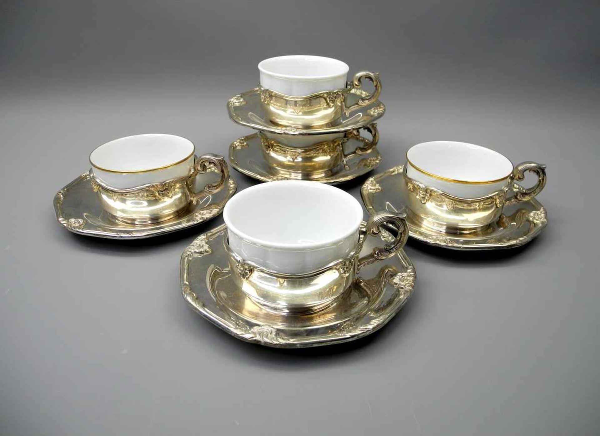 Los 12 - 5 Suppentassen mit Silber-Einfassungen und -UntertellernPorzellan/Silber 800, Teller und